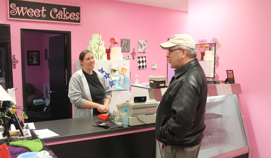 Melissa Klein, co-owner of Sweet Cakes by Melissa in Gresham, Oregon, tells a customer that the bakery has sold out of baked goods to sell for the day on Feb. 5, 2013. (Associated Press) ** FILE **