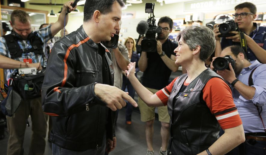 FILE - In this June 6, 2015 file photo, Wisconsin Gov. Scott Walker talks with Sen. Joni Ernst, R-Iowa, before riding in Ernst's fundraising ride in Des Moines, Iowa. (AP Photo/Charlie Neibergall, File)