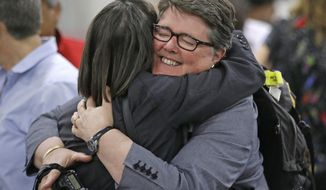 The Rev. Cynthia Black, right, and the Rev. Bonnie Perry, left, hug after Episcopalians voted to allow religious weddings for same-sex couples Wednesday, July 1, 2015, in Salt Lake City. The vote came in Salt Lake City at the denominations national assembly. The measure passed by an overwhelming margin in the House of Deputies, the voting body of clergy and lay people at the meeting. (AP Photo/Rick Bowmer)