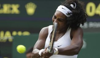 Serena Williams of the United States returns a shot to Timea Babos of Hungary during their singles match at the All England Lawn Tennis Championships in Wimbledon, London, Wednesday July 1, 2015. (AP Photo/Alastair Grant)