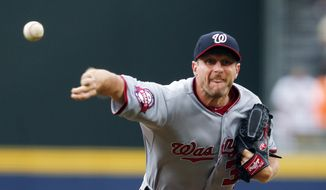 Washington Nationals starting pitcher Max Scherzer works in the first inning of a baseball game against the Atlanta Braves on Thursday, July 2, 2015, in Atlanta. (AP Photo/John Bazemore)