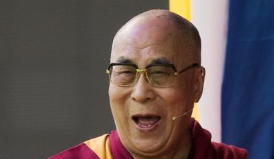Exiled Tibetan spiritual leader Dalai Lama delivers a speech at the ESS Stadium in Aldershot, southern England, on June 29, 2015. The Dalai Lama is celebrating his 80th birthday with a three-day Global Compassion Summit at the University of California, Irvine July 5-7 that will include talks about climate change, the importance of compassion and the presentation of an 8-foot-tall gold-and-maroon birthday cake for His Holiness. (AP Photo/Matt Dunham, File)