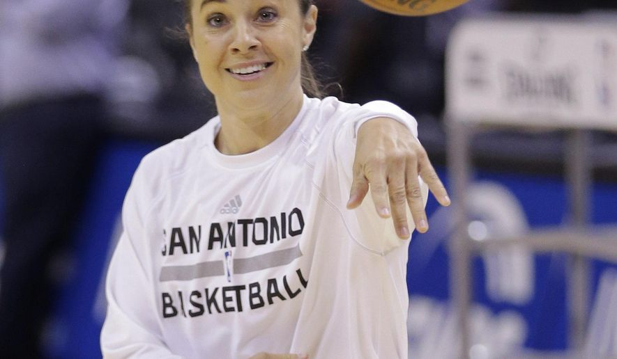 FILE - In this Wednesday, Oct. 22, 2014 file photo, San Antonio Spurs assistant coach Becky Hammon helps with team warmups prior to an NBA preseason basketball game against the Atlanta Hawks in San Antonio. Becky Hammon is about to become the first woman to serve as the head coach of an NBA summer league team. San Antonio announced Friday, July 3, 2015 that Hammon will lead the Spurs during summer league play in Las Vegas.(AP Photo/Eric Gay, File)