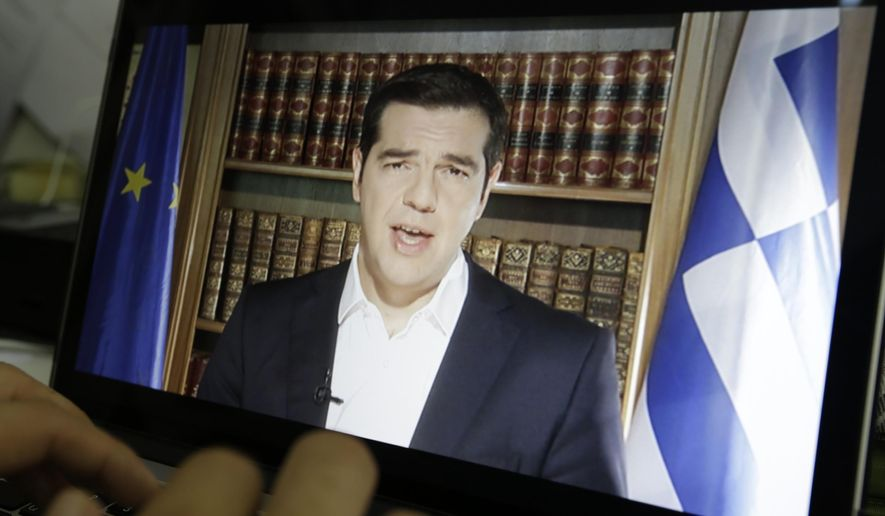 An Associated Press TV producer edits the video of Greece's Prime Minister Alexis Tsipras televised address to the nation in Athens, Friday, July 3, 2015. Tsipras has called on voters to reject creditors' proposals for more austerity in return for rescue loans. He said that Sunday's referendum is not a vote on whether Greece will remain in the euro. (AP Photo/Thanassis Stavrakis)
