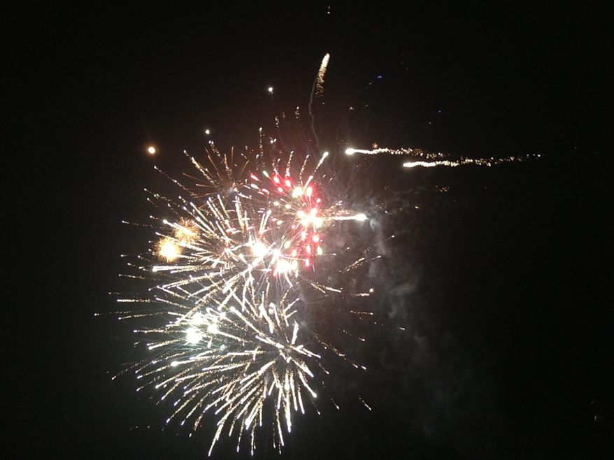 In this photo taken on July 4, 2013, provided by Shawn Walsh, fireworks explode in Kingman, Ariz. For the first time in years, Kingman will not be setting off Independence Day fireworks. (Shawn Walsh via AP)