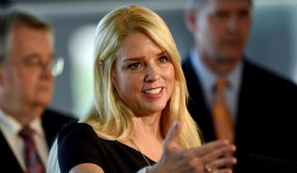 Florida Attorney General Pam Bondi talks about a settlement for the State of Florida with British Petroleum during a press conference held at the Cruiseship Terminal 2 at Port Tampa Bay  in Tampa, Fla., on  July 2, 2015. (Jay Conner/The Tampa Tribune via AP) **FILE**