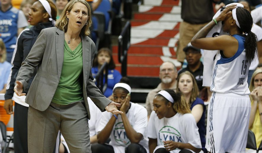 """FILE - In this June 21, 2015, file photo, Minnesota Lynx head coach Cheryl Reeve looks to the referee after her team received a foul during the second half of a WNBA basketball game against Tulsa Shock, in Minneapolis. It sure has been a rough first month of the season for WNBA referees. """"I don't know if the officials really understand the rules,"""" coach Reeve said last week after her team played Phoenix. (AP Photo/Stacy Bengs, File)"""
