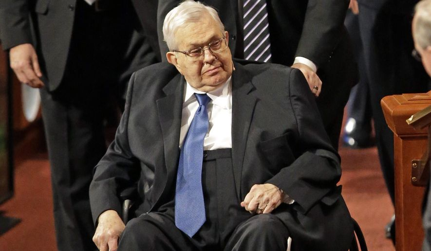 FILE - This April 4, 2015, file photo, shows President Boyd K. Packer, seated, of the Quorum of the Twelve Apostles, of The Church of Jesus Christ of Latter-day Saints, leaving the opening session of the Mormon church conference, in Salt Lake City. Mormon leader Packer, president of the faith's highest governing body, has died. He was 90. Church spokesman Eric Hawkins said Packer died Friday, July 3, 2015, at his home in Salt Lake City from natural causes. (AP Photo/Rick Bowmer, File)