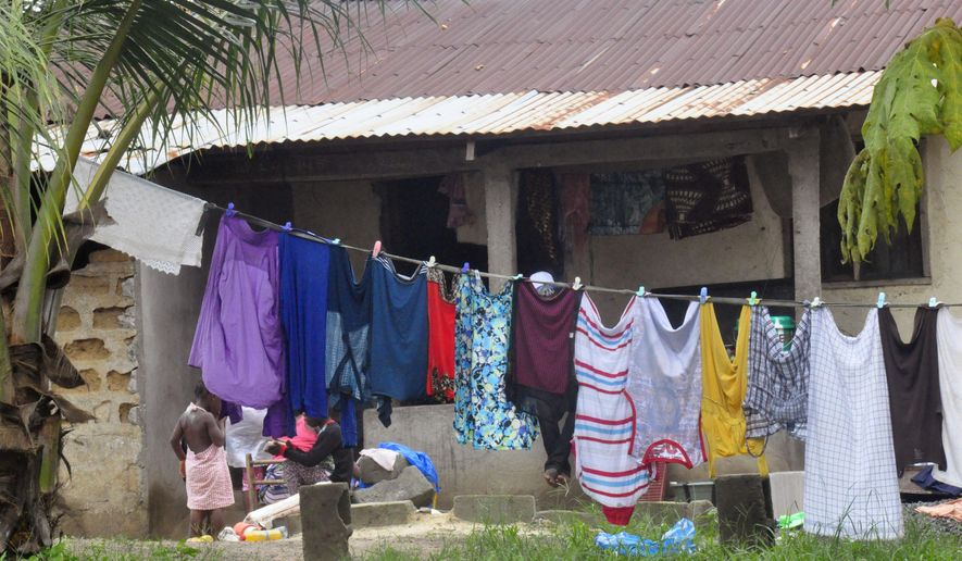 In this photo taken on Wednesday, July 1, 2015, the home where a 17-year-old lived before he died of Ebola is seen after it was placed under Ebola quarantine, on the outskirts of  Monrovia, Liberia.  Authorities say that contact tracing has intensified in the town where a 17-year-old died from Ebola on Sunday, June 28, 2015, as a third person has been found to have the deadly virus. (AP Photo/ Abbas Dulleh)
