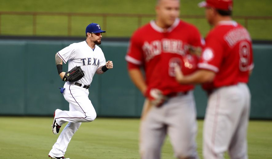 Texas Rangers left fielder Josh Hamilton runs to the dugout in the middle of the first inning of a baseball game against the Los Angeles Angels in Arlington, Texas on Friday, July 3, 2015. (AP Photo/Brad Loper)