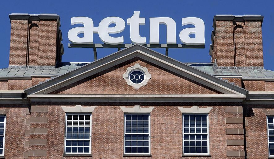 FILE  - In this Tuesday, Aug. 19, 2014, file photo, a sign for Aetna Inc., sits atop a building at the company headquarters in in Hartford, Conn. Health insurer Aetna Inc. has made a deal to buy competitor Humana Inc. in a $37 billion deal the companies say would create the second-largest managed care company, it was announced Friday, July 3, 2014. (AP Photo/Jessica Hill, File)