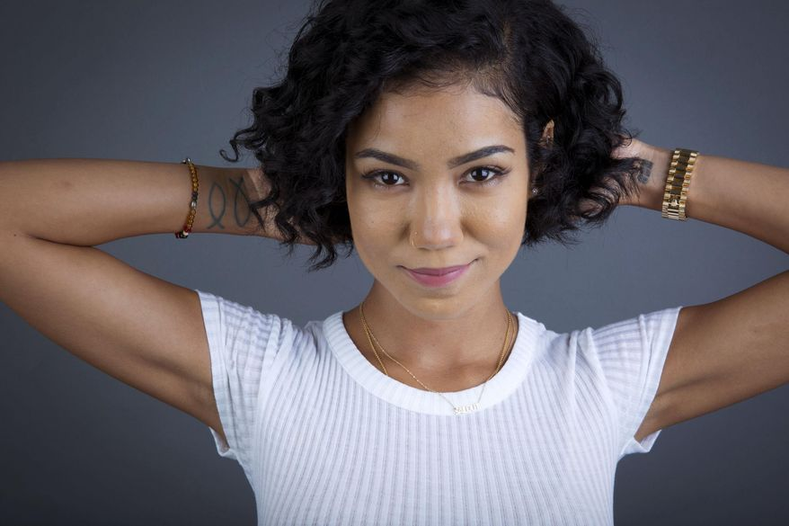 """FILE - In this Sept. 2, 2014 file photo, American singer-songwriter Jhene Aiko poses for a portrait in New York. The soulful singer with the big future has achieved something relatively unusual in the world of Internet memes, a lasting presence beyond 15 fame-filled minutes thanks to her contribution on Omarion's """"Post to Be,"""" a chill but explicit song that has reached No. 13 on Billboard's Hot 100 and No. 5 on the Hot R&B/Hip-Hop songs chart. (Photo by Amy Sussman/Invision/AP, File)"""