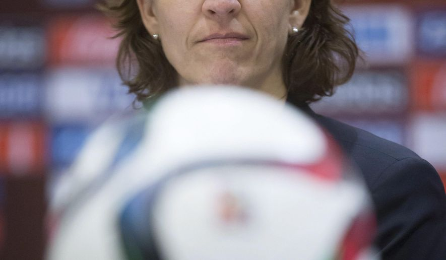 Tatjana Haenni, FIFA deputy director of the competitions division, listens during the closing news conference for the FIFA Women's World Cup soccer tournament in Vancouver, British Columbia, Canada, on Friday, July 3, 2015. The United States and Japan are scheduled to play in the final on Sunday in Vancouver. (Darryl Dyck/The Canadian Press via AP)