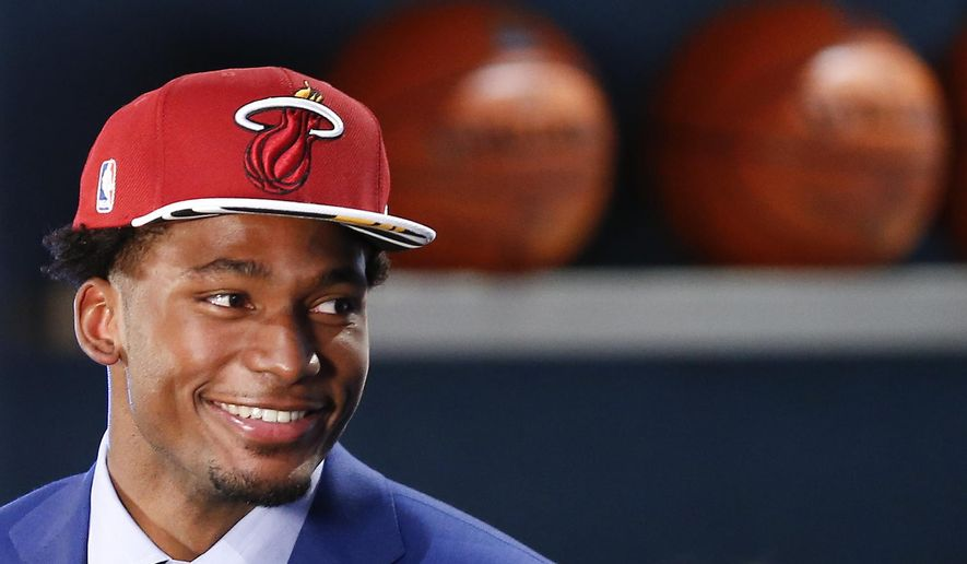 FILE - In this june 25, 2015, file photo, Justise Winslow waits to be interviewed after being selected 10th overall by the Miami Heat during the NBA basketball draft in New York. Summer leagues begin this weekend in Orlando, Florida, games in Salt Lake City set to tip-off on Monday and the 24-team fan-friendly event in Las Vegas opening on July 10. (AP Photo/Kathy Willens, File)
