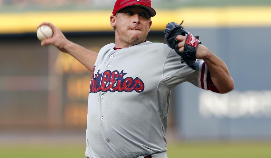 Philadelphia Phillies starting pitcher Kevin Correia works in the first inning of a baseball game against the Atlanta Braves, Saturday, July 4, 2015, in Atlanta. (AP Photo/John Bazemore)