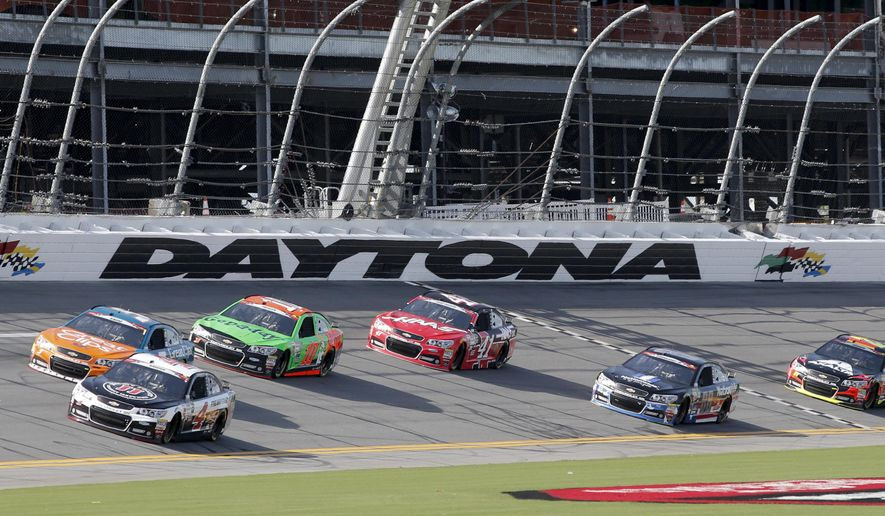 Kevin Harvick (4), Kasey Kahne, top left, Danica Patrick (10), Kurt Busch (41), Dale Earnhardt Jr. (88) and Jeff Gordon (24) drive around the track during a NASCAR Sprint Cup practice session at Daytona International Speedway, Friday, July 3, 2015, in Daytona Beach, Fla. (AP Photo/Terry Renna)