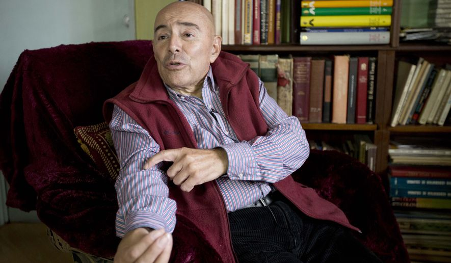"""In this June 19, 2015 photo, Dr. Gustavo Quintana, who helps people with terminal illnesses end their lives, speaks during an interview in Bogota, Colombia. Most of the procedures he performs are in people's home, with the patient surrounded by loved ones. Sometimes music is played. During the nine minutes the procedure typically lasts he whispers the same soothing mantra while injecting a cocktail of lethal drugs: """"Rest, you're going to sleep for the last time, a restorative sleep."""" (AP Photo/Fernando Vergara)"""