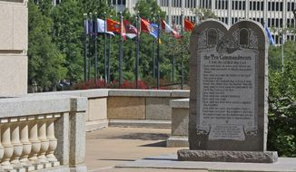 The Ten Commandments Monument is pictured at the state Capitol in Oklahoma City, Okla., on June 30, 2015. The Oklahoma Supreme Court's June 30 decision to order the monument removed from the state Capitol grounds has so angered conservatives in the Legislature that some Republicans are calling for justices to be impeached. (AP Photo/Sue Ogrocki, File)