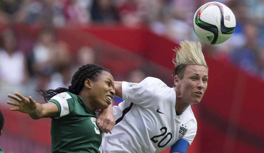 """FILE - In this June 16, 2015, file photo, Nigeria's Onome Ebi, left, and United States' Abby Wambach vie for the ball during a FIFA Women's World Cup soccer game in Vancouver, British Columbia, Canada. With the title match looming, Wambach isn't mincing words. """"All I care about is winning this World Cup,"""" she said. The star U.S. forward is playing in her fourth Women's World Cup, and she says it will be her last. A victory Sunday, July 5, in the final against Japan would be the perfect ending to her World Cup career. (Darryl Dyck/The Canadian Press via AP, File)"""