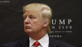 U.S. tycoon Donald Trump attends the inauguration ceremony of the Trump Ocean Club International Hotel and Tower in Panama City, July 6, 2011. (Associated Press) ** FILE **