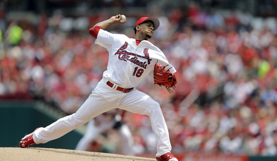 St. Louis Cardinals starting pitcher Carlos Martinez throws during the first inning of a baseball game against the San Diego Padres Saturday, July 4, 2015, in St. Louis. (AP Photo/Jeff Roberson)