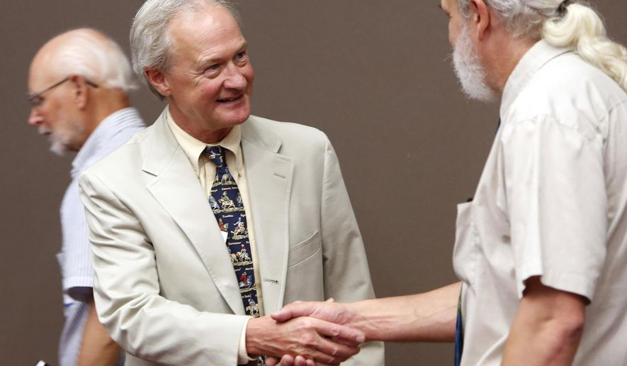 FILE - In this June 24, 2015 file photo, Democratic presidential candidate former Rhode Island Gov. Lincoln Chafee shakes hands as he meets Belknap County Democrats during a campaign stop in Laconia, N.H.  The former Rhode Island governor has visited the first primary state of New Hampshire a dozen times this year. But he seems to be making barely a ripple, aside from curiosity about some of his policy platforms.   (AP Photo/Jim Cole, File)