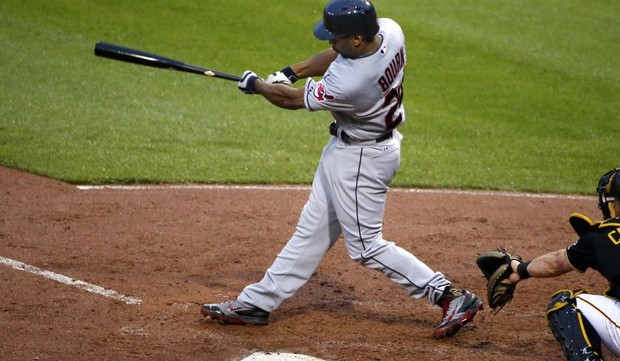 Cleveland Indians' Michael Bourn drives in a run with a double off Pittsburgh Pirates starting pitcher Charlie Morton during the fourth inning of a baseball game in Pittsburgh on Friday, July 3, 2015.(AP Photo/Gene J. Puskar)