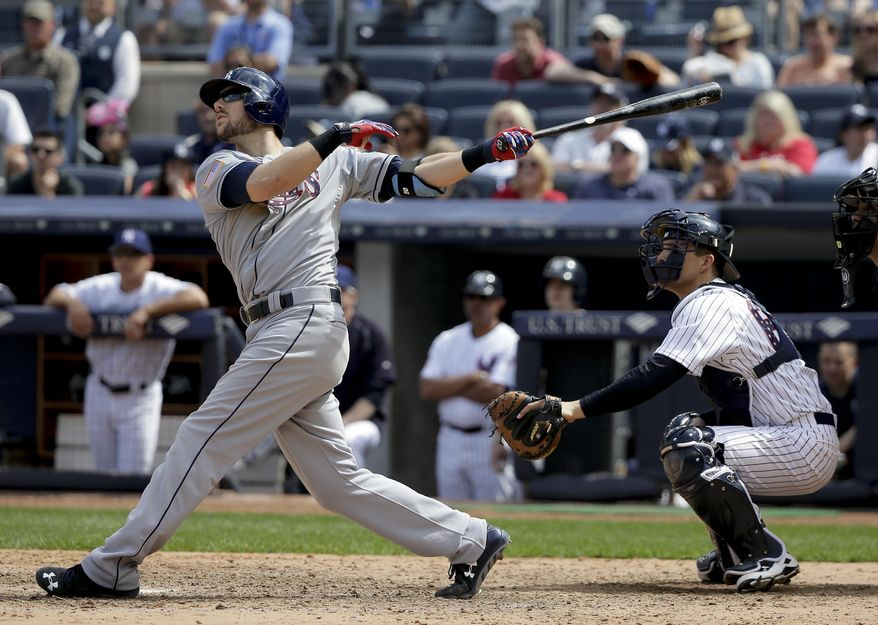 Tampa Bay Rays' Steven Souza Jr. follows through on a two-run home run to tie a baseball game against the New York Yankees during the ninth inning Saturday, July 4, 2015, in New York. The Yankees won 3-2. (AP Photo/Julie Jacobson)