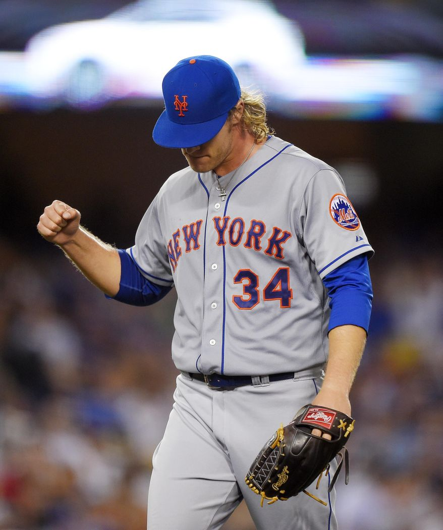 New York Mets starting pitcher Noah Syndergaard gestures after finishing the fourth inning of a baseball game against the Los Angeles Dodgers, Friday, July 3, 2015, in Los Angeles. (AP Photo/Mark J. Terrill)