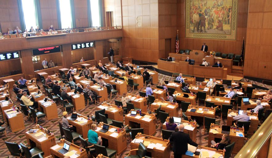 Lawmakers debate bills in the Oregon House of Representatives at the state Capitol in Salem, Ore., Friday, July 3, 2015. Lawmakers raced through remaining business Friday as they pushed to adjourn the legislative session in the coming days. (AP Photo/Jonathan J. Cooper)