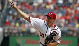 Washington Nationals starting pitcher Stephen Strasburg (37) throws during the first inning of a baseball game against the San Francisco Giants at Nationals Park, Saturday, July 4, 2015, in Washington. (AP Photo/Alex Brandon)