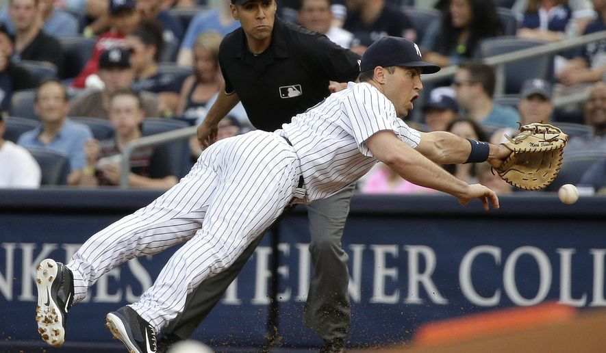 New York Yankees first baseman Mark Teixeira dives unsuccessfully for a ball hit up the line by Tampa Bay Rays Grady Sizemore during the first inning of a baseball game, Friday, July 3, 2015, in New York. (AP Photo/Julie Jacobson)