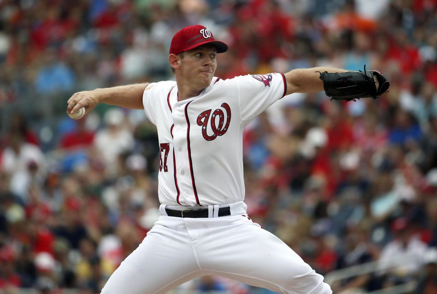 Washington Nationals starting pitcher Stephen Strasburg (37) throws during the  fourth inning of a baseball game against the San Francisco Giants at Nationals Park, Saturday, July 4, 2015, in Washington. (AP Photo/Alex Brandon)