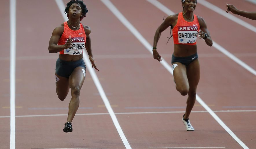 Shelly-Ann Fraser-Pryce of Jamaica, left, runs to win the women's 100m event ahead of American English Gardner, right, at the IAAF Diamond League athletics meeting at Stade de France stadium in Saint Denis north of Paris, France, Saturday July 4, 2015. (AP Photo/Michel Euler)