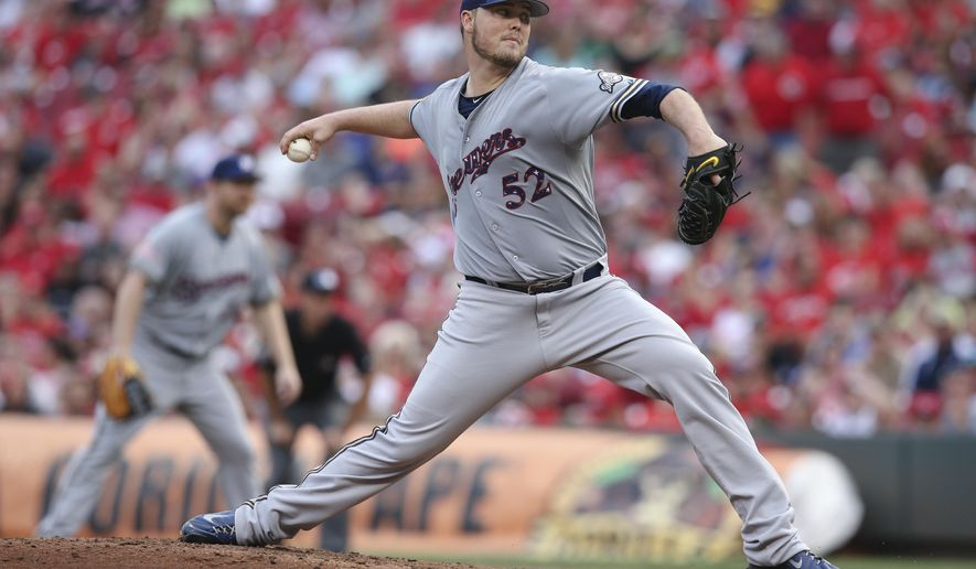 Milwaukee Brewers starting pitcher Jimmy Nelson throws during the third inning of a baseball game against the Cincinnati Reds, Saturday, July 4, 2015, in Cincinnati. (AP Photo/John Minchillo)