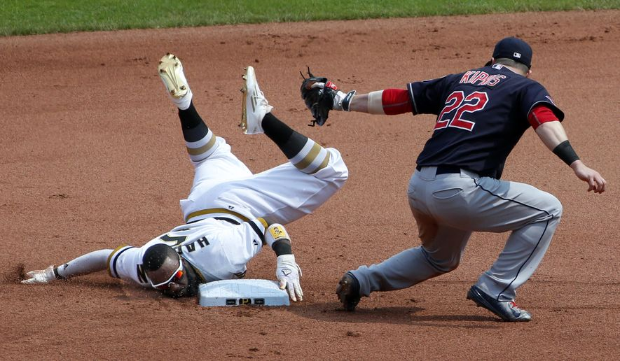 Pittsburgh Pirates' Josh Harrison (5) holds the second base bag as he steals second ahead of the tag by Cleveland Indians second baseman Jason Kipnis (22) during the seventh inning of a baseball game in Pittsburgh Sunday, July 5, 2015.(AP Photo/Gene J. Puskar)