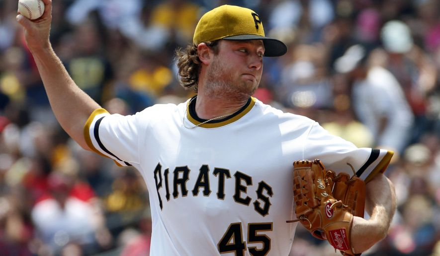 Pittsburgh Pirates starting pitcher Gerrit Cole delivers during the first inning of a baseball game against the Cleveland Indians in Pittsburgh, Sunday, July 5, 2015. (AP Photo/Gene J. Puskar)