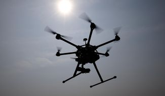 In this June 11, 2015, file photo, a hexacopter drone is flown by Doug Bennett, senior technician and operator for Intelligent UAS, during a drone demonstration at a farm and winery on potential use for board members of the National Corn Growers in Cordova, Md. (AP Photo/Alex Brandon) ** FILE **