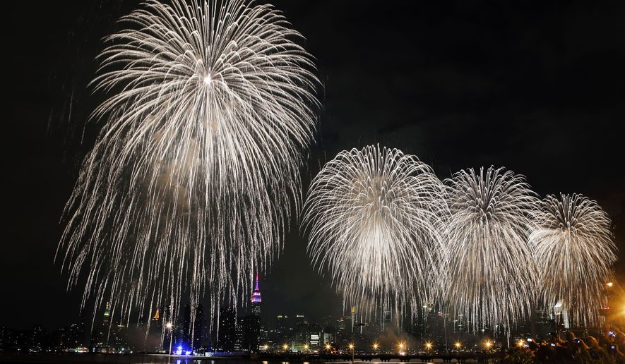 Fireworks explode over the East River in front of the Manhattan skyline as photographed from the Brooklyn borough of New York during the Macy's Fourth of July fireworks show Saturday, July 4, 2015. (AP Photo/Jason DeCrow)