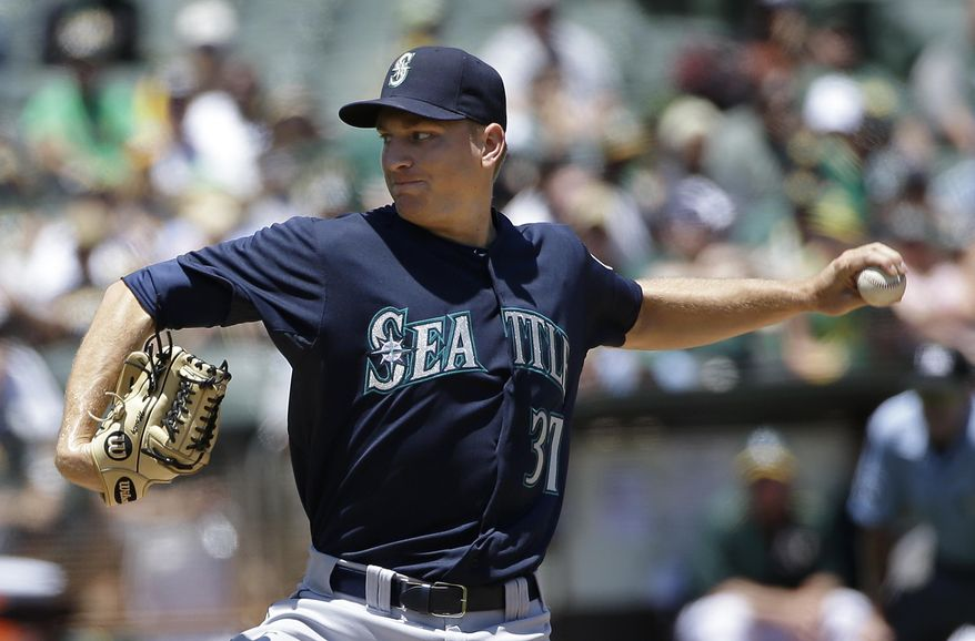 Seattle Mariners pitcher Mike Montgomery throws against the Oakland Athletics during the second inning of a baseball game in Oakland, Calif., Sunday, July 5, 2015. (AP Photo/Jeff Chiu)