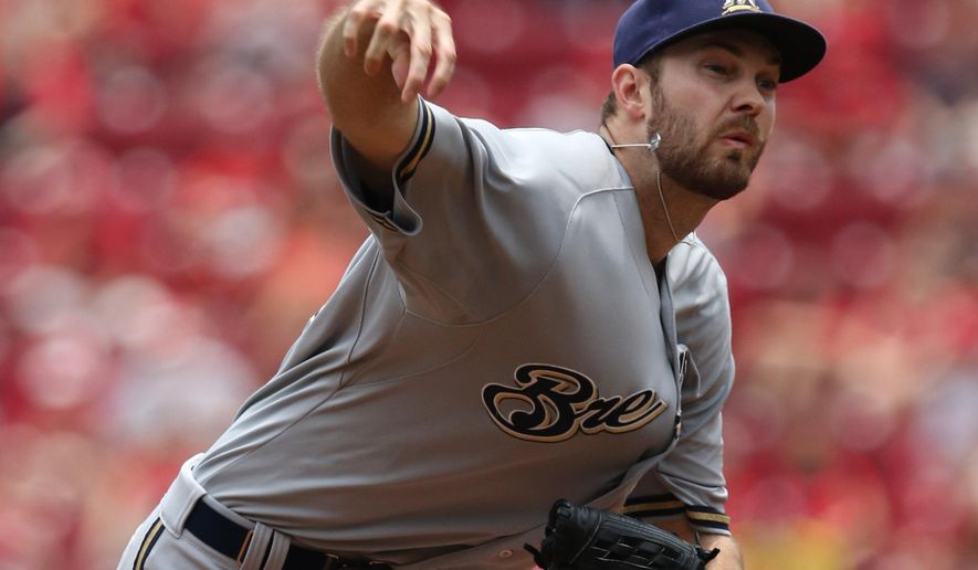 Milwaukee Brewers starting pitcher Taylor Jungmann throws against the Cincinnati Reds during the first inning of a baseball game Sunday, July 5, 2015, in Cincinnati. (AP Photo/Gary Landers)