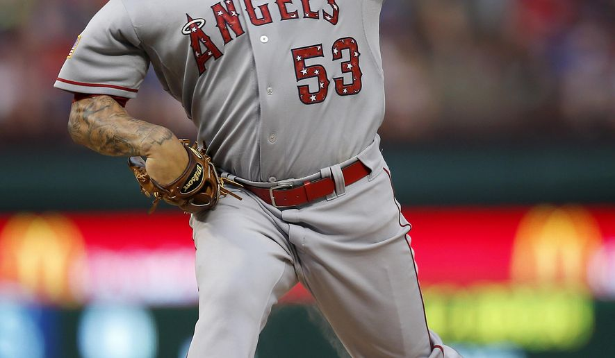 Los Angeles Angels starting pitcher Hector Santiago throws against the Texas Rangers during the first inning of a baseball game in Arlington, Texas, on Saturday, July 4, 2015. (AP Photo/Brad Loper)