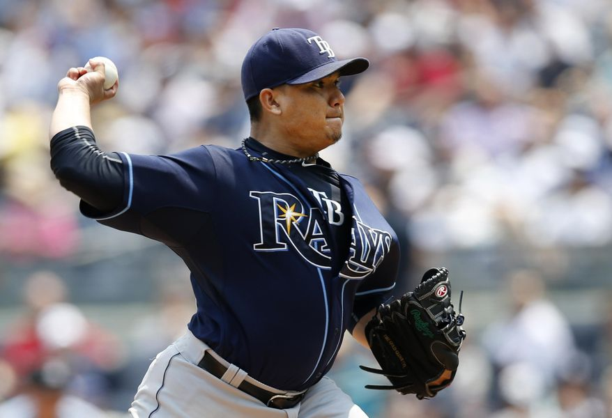 Tampa Bay Rays starting pitcher Erasmo Ramirez winds up in the first inning of a baseball game against the New York Yankees at Yankee Stadium in New York, Sunday, July 5, 2015. (AP Photo/Kathy Willens)