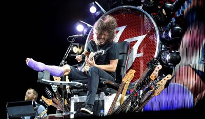 "The Foo Fighters' Dave Grohl performs from a throne of his own making, after breaking his leg during a show in Sweden. A specially designed gurney allowed Mr. Grohl's chair to extend onto a catwalk to get him closer to the crowd, sometimes with bandmates joining him. ""There was no way I was canceling this concert,"" Mr. Grohl told the enthusiastic crowd. (Associated Press photographs)"