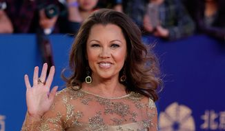 In a Thursday, April 23, 2015, file photo, Vanessa Williams waves as she arrives on the red carpet for the closing ceremony of the 5th Beijing International Film Festival in the Huairou district of Beijing. Saturday, July 4, 2015. (AP Photo/Andy Wong, File)