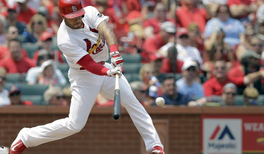 St. Louis Cardinals' Tommy Pham hits a two-run home run during the third inning of a baseball game against the San Diego Padres, Sunday, July 5, 2015, in St. Louis. (AP Photo/Jeff Roberson)