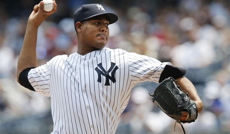 New York Yankees starting pitcher Ivan Nova delivers in the first inning of a baseball game against the Tampa Bay Rays at Yankee Stadium in New York, Sunday, July 5, 2015. (AP Photo/Kathy Willens)