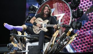The Foo Fighters' Dave Grohl performs at RFK Stadium on Saturday, July 4, 2015, in Washington. (Photo by Nick Wass/Invision/AP) ** FILE **