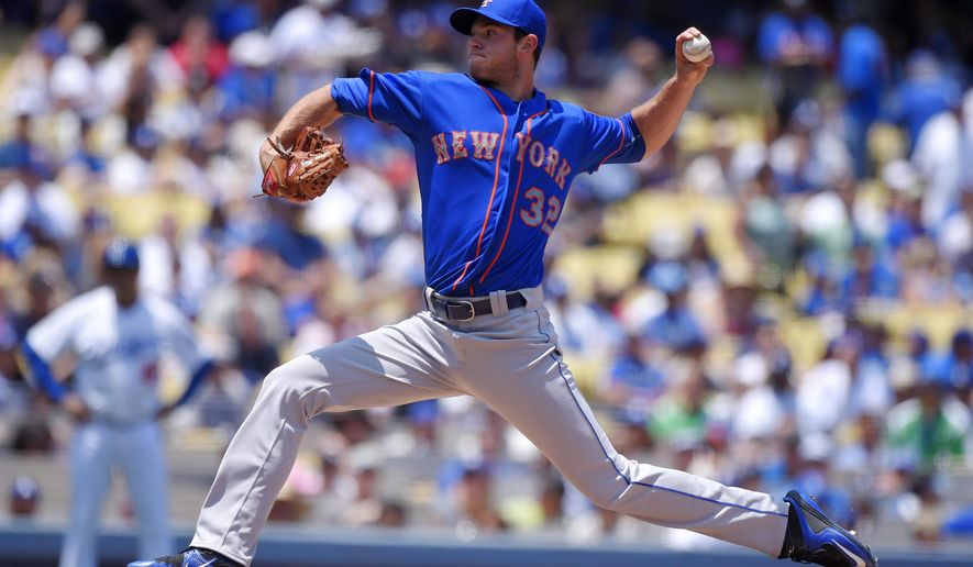 New York Mets starting pitcher Steven Matz throws to the plate during the first inning of a baseball game against the Los Angeles Dodgers, Sunday, July 5, 2015, in Los Angeles. (AP Photo/Mark J. Terrill)