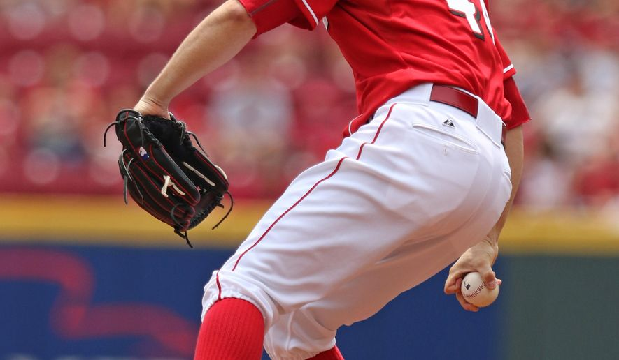 Cincinnati Reds starting pitcher Mike Leake throws against the Milwaukee Brewers during the first inning of their baseball game Sunday, July 5, 2015, in Cincinnati. (AP Photo/Gary Landers)